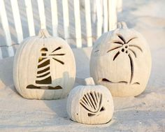 Beach pumpkins... carved with coastal motif and covered with sand! Featured on CC: http://www.completely-coastal.com/2015/09/sand-pumpkins-beach-house-fall.html