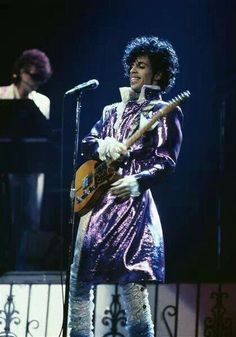 A rare picture of Prince smiling with Dr. Fink in the background working his Arp!