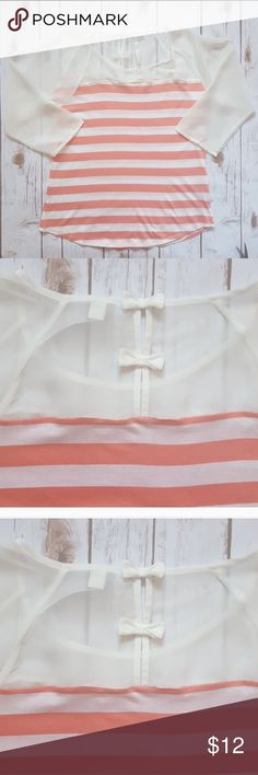 """lc lauren conrad striped mixed media top This top is perfect for when you want the cool feeling of a tank, but the coverage of sleeves. Love the adorable bow detail in the back!   •Excellent condition •Smoke-free home •Cotton/modal/poly  Measurements:  •Length: 24"""" •Width (underarm): 17""""  I do not currently offer a bundle discount closet-wide, but I will work with you on pricing.   No trades, please.  Thank you for shopping my closet, it means a lot to me! LC Lauren Conrad Tops Tees - Long…"""