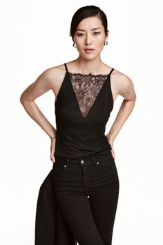 Top with lace detail: Sleeveless jersey top with narrow shoulder straps and a lace-covered V-neck at the front.