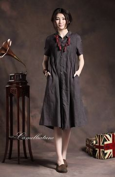 Linen Shirt Dress in Charcoal for women  【Details】 1. beautiful handmade tucks all on the front and back 2. single breasted with wood buttons. 3. stand collar. 4. two pockets. 5. flattering bottom simple graceful.  【Fabric】 •High-end linen developed by Camelliatune in this quarter •100% linen •Use 66-yarn fabric to form distinct texture through special weaving method Looks special and beautiful at first sight 【Size】 Based on approximate body measurements. •SIZE XS (US 0-2 | UK/AU 4-6 | D...