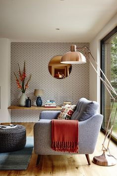 I love love love that pop of graphic pattern-a little wallaper goes a long way! Family room design. copper living room, large floor lamp