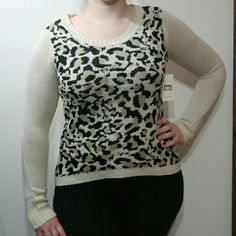 🆕  Leopard Animal print sweater L.e.I leopard print winter sweater. New with tags. Crewneck neckline and high low hemline. l.e.i Life Energy Intelligence Sweaters Crew & Scoop Necks