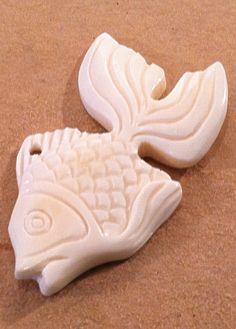 Carved bone fish pendant