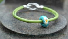lampwork bead on a nappa leather cord bracelet with silver plated clasp