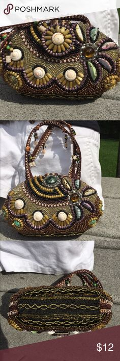 "Beaded Bag Hard exterior covered in beads and shells. All are in place. The inside is pulling away from the base on both sides so it will need some sort of glue to fix it, there is not a brand. 7"" across  41/2 ""  my iPhone 6 does not fit . No brand  Bags Clutches & Wristlets"