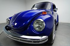 1973 VW Super Beetle. My folks had a beige one in which I learned to drive!  (ô.\_!_/.ô)