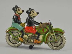 *VINTAGE ~ c.1932 Tippco (Germany) lithographed-tin clockwork motorcycle, 9¼ inches long with desirable toothy, five-fingered depictions of Mickey and Minnie Mouse, 23,000-28,000 dollars.
