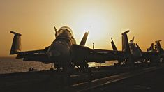 "#USNavy F/A-18C Hornets on the flight deck off of the USS Dwight D. Eisenhower ""Ike."" Ike and it's #sailors are operating in the U.S. 6th Fleet area of responsibility supporting maritime security operations. #sunset"