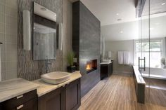 Nice symmetry created by #fireplace centered between twin vanities. JAUREGUI Architecture