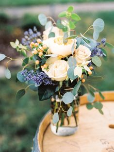 Rose and lavender floral wedding arrangement: http://www.stylemepretty.com/oregon-weddings/medford-oregon/2015/11/06/romantic-southern-oregon-orchard-wedding/ | Photography: Olivia Leigh - http://www.olivialeighphotoart.com/