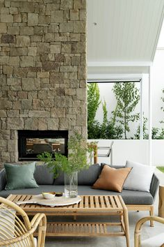 This gorgeous stone wall is a feature of this home extension completed by Red Lily Renovations. The wall runs from the inside out to this beautiful alfresco area. Stone Feature Wall, Stacking Doors, Red Lily, Alfresco Area, Stone Masonry, Stone Cladding, House Extensions, Fireplace Mantle, Outdoor Ideas