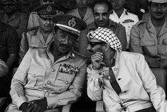 President Anwar Sadat and PLO leader Yasser Arafat reviewing the Egyptian Army units. 1974