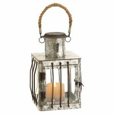 """From its rope handle to its weathered metal design, this charming candle lantern brings rustic style home.  Product: Candle lanternConstruction Material: Metal, glass and ropeColor: Silver and brownAccommodates: (1) Candle - not includedDimensions: 11"""" H x 7"""" W x 7"""" D"""