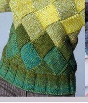 Pull tricoté avec entrelacs