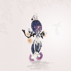 """An exercise in style"" by Van Cleef & Arpels - Creation. Perroquet mystérieux clip, 2011 - white gold, red gold, colored sapphires, onyx, chalcedony, pink opal, black spinels, Mystery-Set™ colored sapphires and diamonds."