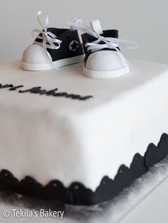 black and white christening cake with fondant shoes #christeningcake #fondantcake #fondantshoes www.tekila.fi