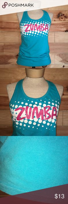"""Zumba Fitness Join The Party Racerback Tank Top Zumba Fitness join the party racerback tank top. Size x-large. Blue with white bubbles and pink writing. Very small hole towards bottom of front as pictured. 90% cotton and 10% spandex. 32"""" bust. 23"""" length. No trades, offers welcome! Zumba Fitness Tops Tank Tops"""