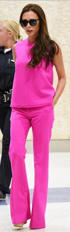 "Victoria Beckham arrives in to JFK for her fashion collection show "" VICTORIA BECKHAM"" adorned in her 2016 collection in pink - Top and pants: Victoria Beckham Collection"