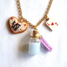 @Elaine Silva This made me think of you :)  Alice in Wonderland Drink Me Eat Me Charm Necklace by FatallyFeminine, $32.00