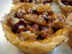 Mini Pecan Pie-super gooey, using liners in the muffin pan helps a lot Mini Desserts, Just Desserts, Delicious Desserts, Dessert Recipes, Yummy Food, Small Desserts, Mini Pecan Pies, Pecan Tarts, Mini Pies