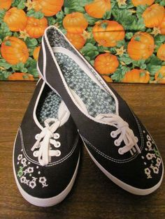 KEDS    WOMENS BLACK    BALLET STYLE    SNEAKERS WITH ARCH SUPPORT    SIZE 8M    MINT CONDITION    FOR PREOWNED    MINIMAL WEAR    CUTE EMBROIDERED FLOWERS    10 IN LENGTH    3 ¼ IN WIDTH    SUPER CUTE    WONDERFUL ADDITION    TO YOUR WARDROBE