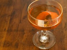 Orange Manhattan  1 1/2 ounces whiskey  1/2 ounce sweet vermouth  3/4 ounce orange liqueur like cointreau  dash of orange bitters  orange peel to garnish