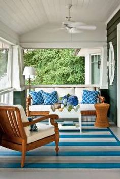 Kelley Proxmire of Kelley Interior Design, Bethesda, MD, designed this nautical porch with a subtle ... - Photo: Laurey W. Glenn