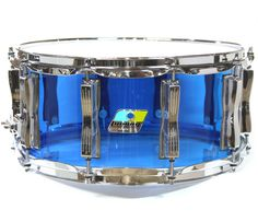 "Ludwig Blue Acrylic snare drum, 14"" x 6.5"" http://www.drumshop.co.uk/collections/snare-drums/products/ludwig-14x-6-5-vistalite-snare-drum-in-blue-acrlyic"