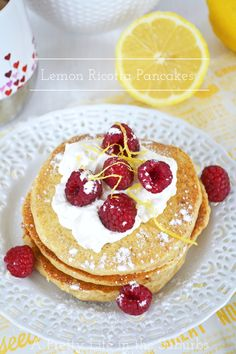 Lemon Ricotta Pancakes with whipped cream and fresh berries!  {A Pretty Life}