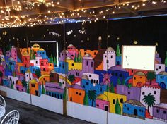 Exterior Sukkot Decorations With Decorative Light On The Wall Painting Of A Lot Of Buildings In A City And Densely Populated Basic About Sukkot Decorations