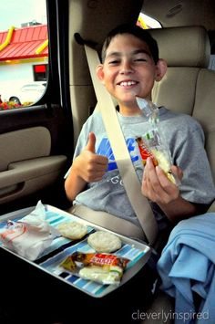 DIY car snack trays... This is so creative and will help with the crumbs all over the back seat! :)