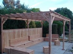 Larch Pergola with intergrated seating and storage