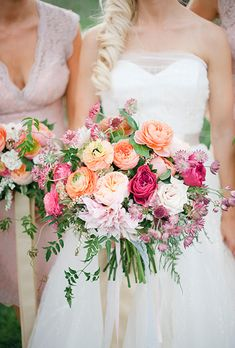 Yep, love dahlias and ranunculus. Kind of like this size too, though I would probably go for a cleaner look with a little less foliage. | Brides.com: . Bouquet of garden roses, dinner plate dahlias, ranunculuses, Sahara roses, jasmine vines, scabiosas, andromedas, astrantias, and lilac foliage, $325, Munster Rose