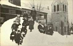 """A Sunday School class gather on the """"lawn"""" out side the Chrost Episcopal Church parsonage after the blizzard of February 14, 1914"""