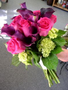 Color, color, color!  Hot pink roses, eggplant calla lilies, with a collar of green hydrangea