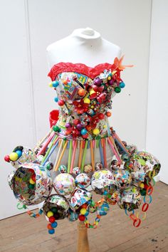 Gumballs, comic book pages, straws, paper. Artist unknown.  The creativity of the forms in this piece is what drew me to it. I like how the disparate parts are brought together by the theme and color.