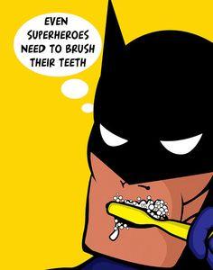 "Superhero ""toothbrush"" wall hanging."