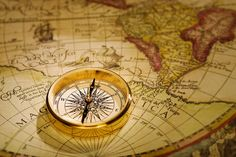 Compass and Antique Map
