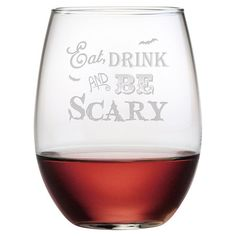Host a charming Halloween-themed dinner party with this playful wine glass, featuring a sand-etched text motif.  Product: Set of...