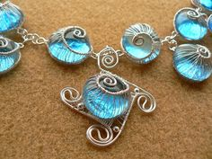 Blue woven snails jewelry | JewelryLessons.com