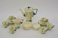 An Art Deco Burleighware six piece 'Bluebell' pattern coffee set painted in blue and green with Machine Age, The Saleroom, Coffee Set, Tea Cups, Two By Two, Art Deco, Porcelain, Auction, Place Card Holders