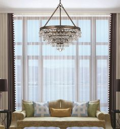 Our Calypso chandelier is beautiful in this room.  The Crystal teardrops sparkle on its bronze finish.
