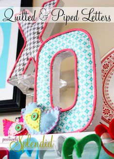 fabric and piping on paper mache letters...cool.