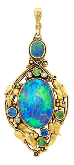 An Art Nouveau Gold, Black Opal, Sapphire, Demantoid Garnet and Diamond Pendant, Circa 1900. Topped by one oval black opal, centring one oval black opal approximately 22.2 x 16.0 mm., within a polished leaf frame accented by 3 round and oval demantoid garnets, 2 round sapphires and 3 single-cut diamonds. #GoldJewelleryArtNouveau