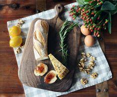 A handmade walnut cutting board doubles as a beautiful platter.