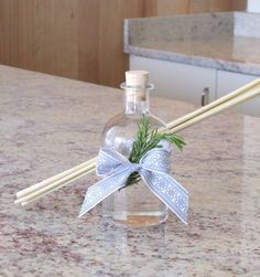 #DIY essential oil reed #diffuser. Perfect for a holiday gift that will last for months to come! This natural fragrance will brighten anyone's home and, to top it off, it's cute!