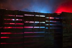backlit pallet fence inspiration #lighting- great idea for a home haunting. Actors can hide behind the walls ready to scare people as they walk through Dog Fence, Brick Fence, Front Yard Fence, Pallet Fence, Farm Fence, Cedar Fence, Fence Gate, Pallet Planters, Fence Stain
