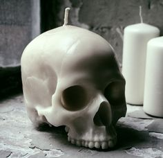spookyloop: Skull Candle, at Firebox Cast from a real skull. But someone cool Burns for over one hundred hours Handmade in the UK Does not contain a large waxy brain So highly-detailed that people will think you dug it up yourself