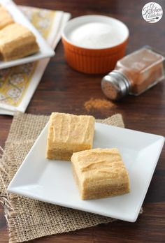 Pumpkin Snickerdoodle Cookie Bars with Pumpkin Buttercream Frosting from @akitchenaddict